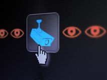 Protection concept: Camera And Eye on digital computer screen. Protection concept: pixelated Camera And Eye icon on button with Hand cursor on digital computer Stock Photo