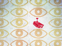 Protection concept: cctv camera icon on Digital. Protection concept: rows of Painted yellow eye icons around red cctv camera icon on Digital Paper background, 3d Stock Photos