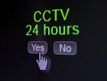 Protection concept: CCTV 24 hours on digital. Protection concept: buttons yes and no with pixelated word CCTV 24 hours and Hand cursor on digital computer screen Royalty Free Stock Image