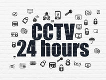 Protection concept: CCTV 24 hours on wall. Protection concept: Painted black text CCTV 24 hours on White Brick wall background with  Hand Drawn Security Icons Stock Photos