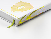 Protection concept: closed book, Shield With Royalty Free Stock Photo