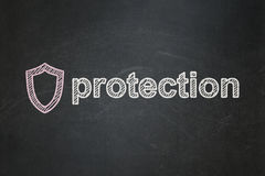 Protection concept: Contoured Shield and. Protection concept: Contoured Shield icon and text Protection on Black chalkboard background, 3d render Stock Photos