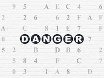 Protection concept: Danger on wall background. Protection concept: Painted black text Danger on White Brick wall background with Hexadecimal Code vector illustration