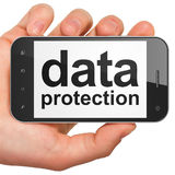 Protection concept: Data Protection on smartphone. Protection concept: hand holding smartphone with word Data Protection on display. Mobile smart phone in hand royalty free illustration