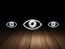 Protection concept: eye icon in grunge dark room Stock Photo
