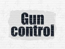 Protection concept: Gun Control on wall background Stock Images