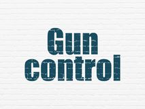 Protection concept: Gun Control on wall background Royalty Free Stock Photos