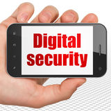 Protection concept: Hand Holding Smartphone with Digital Security on display Royalty Free Stock Images