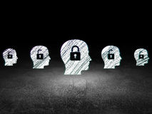 Protection concept: head with padlock icon in. Protection concept: row of Glowing head with padlock icons around head with padlock icon in grunge dark room Dirty Stock Photography