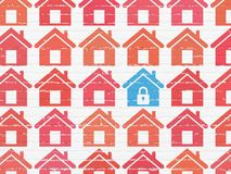 Protection concept: home icon on wall background. Protection concept: rows of Painted red home icons around blue home icon on White Brick wall background Royalty Free Stock Image