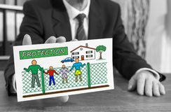 Protection concept on an index card. Businessman showing an index card with protection concept royalty free stock photography