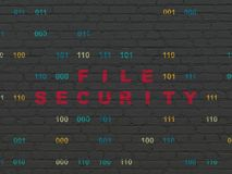 Protection concept: File Security on wall background. Protection concept: Painted red text File Security on Black Brick wall background with Binary Code Royalty Free Stock Photo