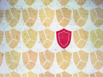 Protection concept: shield icon on Digital Paper Royalty Free Stock Photos