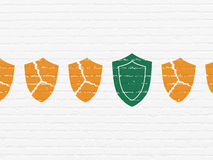 Protection concept: shield icon on wall background Stock Photos