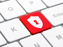 Protection concept: Shield With Keyhole on computer keyboard bac Royalty Free Stock Image