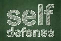 Protection concept: Self Defense on chalkboard background. Protection concept: text Self Defense on Green chalkboard background Royalty Free Stock Photography