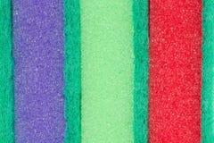 Protection de pourpre, verte et rouge de récurage Photo stock