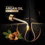 Protection de soins capillaires d'huile d'argan contenue dans la bouteille Images libres de droits