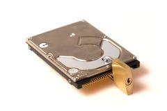 Protection des données : Disque dur avec le cadenas Photographie stock