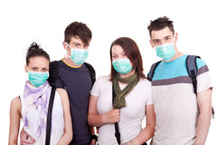 Protection from epidemic. Group of young people with masks for protection Royalty Free Stock Photography