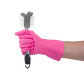 Protection glove holding a dish-brush Royalty Free Stock Photos