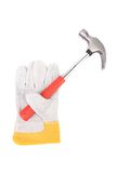 Protection glove holding hammer. Stock Photography