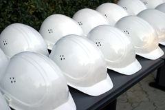 Protection helmet. A set of protection helmets on a bench Royalty Free Stock Image