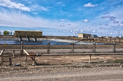 Protection of an industrial zone against the cloudy sky. Industrial platform against the cloudy sky in the desert of Central Asia Stock Photo