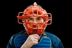 Protection mask on catcher`s face stock image