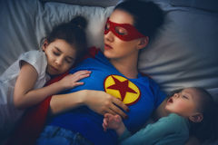 Protection of the mother superhero stock images