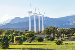 Protection of nature. Wind turbines against mountains landscape. Stock Photography