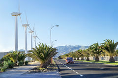 Protection of nature. Wind turbines against mountains and near road. Stock Images