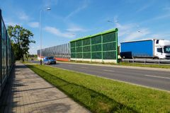 Protection of residents against noise generated by car traffic. Double sound absorbing panels separating lanes. Protection of residents against noise generated stock photo