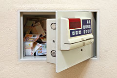Protection and security. Steel safe with money. Concept of a Reliable protection and security Stock Photography