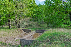 Protection of soil from erosion. The concrete hydraulic structure for the protection of soil from the impact of the erosion of melt water and rain water Royalty Free Stock Photos