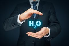 Protection of water. As business plan. Protective gesture and H2O text stock photos
