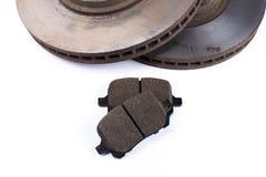 Protections de frein et disques de frein sur le fond blanc images libres de droits