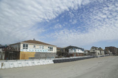 Protective barrier build to prevent damage in devastated residential area one year after Hurricane Sandy. FAR ROCKAWAY, NY - OCTOBER 22: Protective barrier build royalty free stock photography