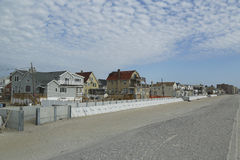Protective barrier build to prevent damage in devastated residential area one year after Hurricane Sandy. FAR ROCKAWAY, NY - OCTOBER 22: Protective barrier build royalty free stock photos