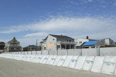 Protective barrier build to prevent damage in devastated residential area one year after Hurricane Sandy. FAR ROCKAWAY, NY - OCTOBER 22: Protective barrier build stock images