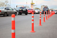 Protective barrier made of columns on road Stock Photo