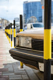 Protective barrier made of yellow striped columns. On road and car royalty free stock photography