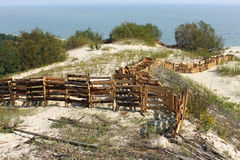 Protective barriers in the dunes of the Curonian Spit National Park. Stock Photos