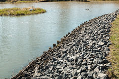 Protective breakwater. On the pond Royalty Free Stock Images