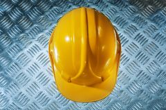 Protective building helmet on grooved metal sheet.  stock photo
