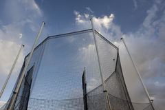 Protective cage for a hammer throw competition. Protective cage for a hammer or ball throw competition against cloudy sky stock images