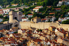 Protective city wall, Minceta tower and houses with red tiles in Dubrovnik, Croatia. Protective city wall, Minceta tower and houses with red tiles in Dubrovnik Stock Images