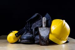 Protective Clothing And Tools Lying On The Workshop Table. Buy A Stock Images
