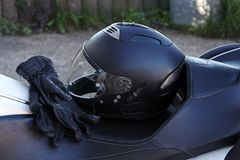 Protective clothing when riding a motorcycle. Motorcycle helmet and gloves are an important protection stock photos