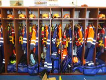 Protective clothing in storage rack. Protective clothing and helmets for marine search and rescue services in storage racks at Burnham-on-Sea in Somerset Royalty Free Stock Images